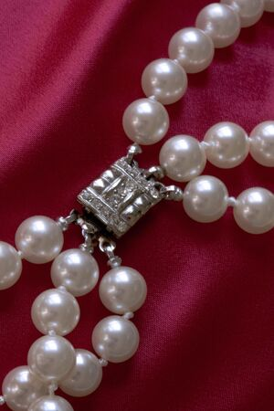 clasp: Pearls and Clasp on Red Silk
