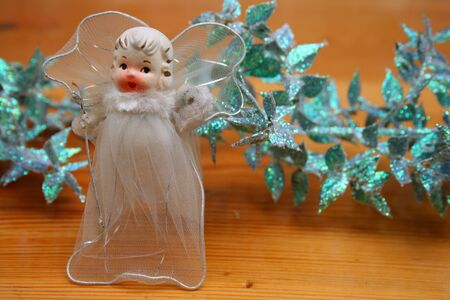a christmas decoration with a christmas fairy photo