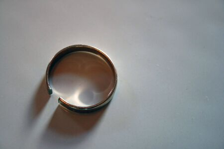 seperation: a broken white gold ring Stock Photo