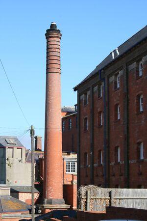 tall chimney: a tall brick chimney Stock Photo