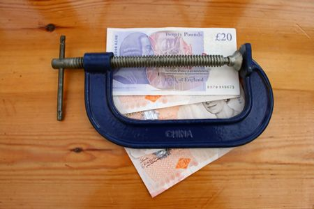 thread count: English pound notes and cramp tool. Stock Photo