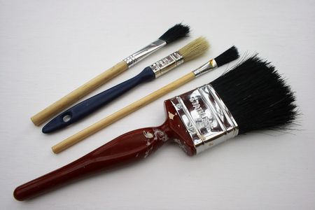 A set of four paint brushes. Imagens
