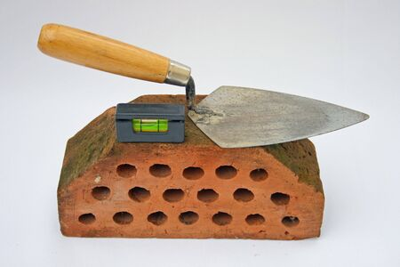 Trowel,spirit level and a brick.