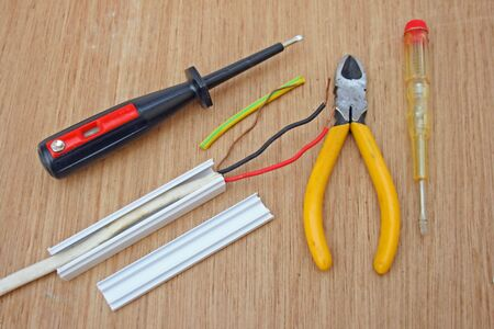 bare wire: Electrical wiring and tools. Stock Photo