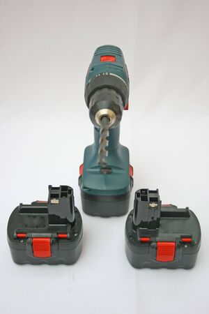 Cordless drill and spare batteries.