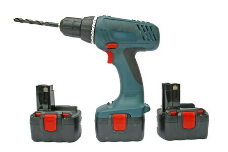 Cordless drill and bit with spare batteries. Imagens