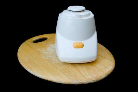 Food blender motor on wooden chopping board. photo
