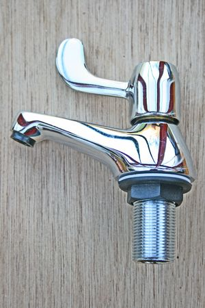 Lever tap with plastic washer.