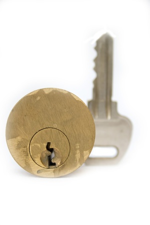 Cylinder lock and key on plain background. photo