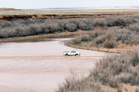Off Road Truck Driving Through Flooded River in Arizona