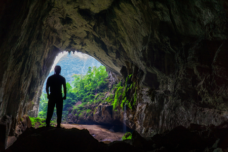 Hang En Cave - Silhouette of Man Standing Inside World's 3rd Largest Cave in Vietnam Reklamní fotografie