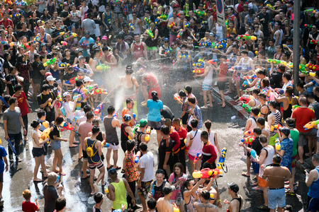 Watergun fight at Songkran Water Festival in Silom, Bangkok, Thailand - 04132016