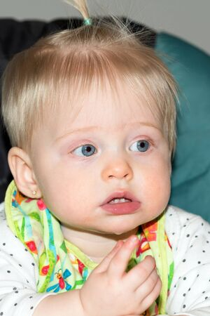 Baby Teething : Cute Girl Shows First Teeth, Baby with Bright Blue Eyes