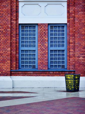 brich: Esthetic windows composed in brich building with a bin