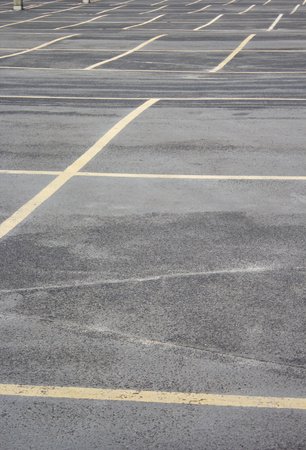 dividing lines: Grungy photo of a dividing lines on the parking lot.
