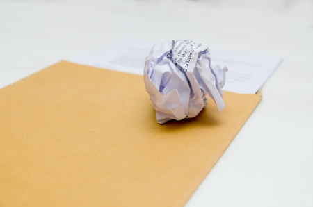 Crumpled paper on envelope, Crumpled contract photo