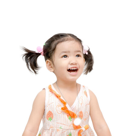 Happy asian girls on the white background 스톡 콘텐츠