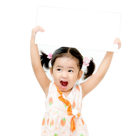 The girl holding blank board isolated on white  photo