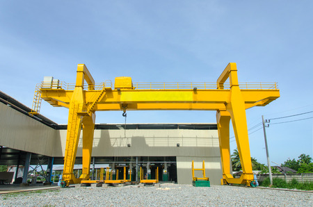 Yellow overhead crane for factory Stock Photo