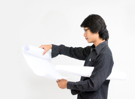 asian architect: Young asian man architect looking to plan blank paper