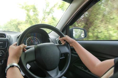 A woman driving a car  photo