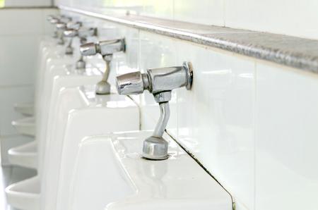 Mens Toilet ceramic bow restroom Stock Photo - 28117889