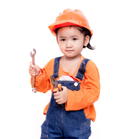 Asian Engineer baby with tools in hand Isolated on white background Stock Photo