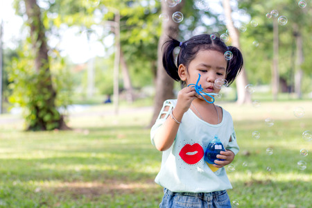 Asian baby girl playing bubble balloon photo