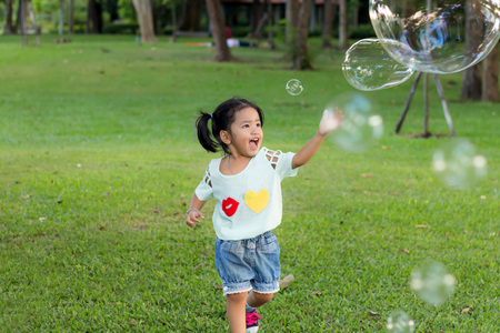 Smile asian baby girl play bubble balloon photo