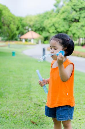 asian baby girl: Asian baby girl playing bubble Stock Photo