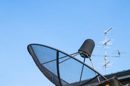 sattelite: Sattelite disk and antenna Stock Photo