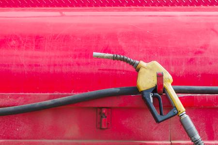 pumper: Gas pumper on red background Stock Photo