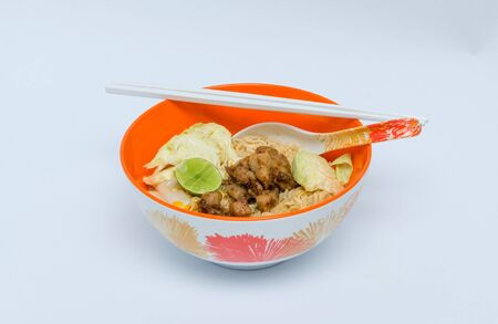 cooked instant noodle: Cooked  instant Noodle in orange bowl on the white background