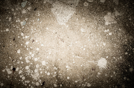Abstract splash of white color on cement background texture(Grunge and low key processed)