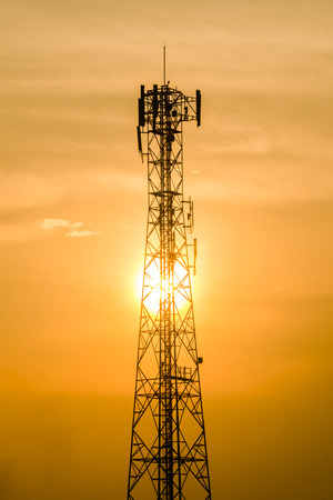 Communication tower on sunset background