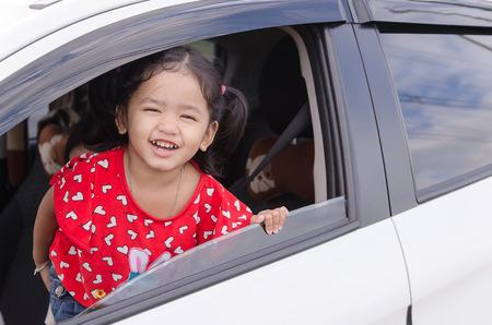 smilie: Smilie asian baby girl in white car