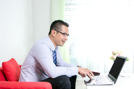 happy asian people: Asian business man using laptop computer with happiness