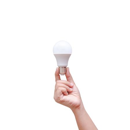 Mano della donna che tiene la lampadina del LED isolata su fondo bianco Archivio Fotografico - 64524819
