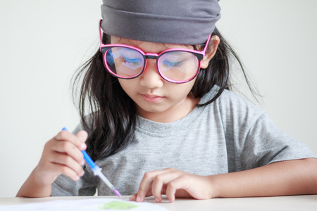 dept: Close up shot of Asian little girl painting color shallow dept of field Stock Photo