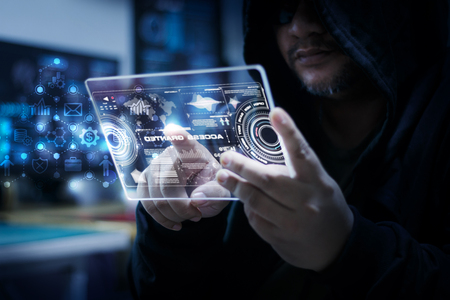 Hacker using clear tablet with HUD panel and code graph bar data analytsis element for cyber technology concept, dark and grain process, shallow depth of field select focus on hands Stock Photo