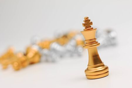 battle plan: Gold Chess on white background for business metaphor leadership concept select focus on king chess shallow depth of field