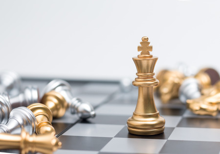 battle plan: Gold Chess on chess board game for business metaphor leadership concept select focus on king chess shallow depth of field