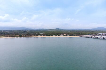Scenic landscape of big river and reservoir dam with mountain and nature forest