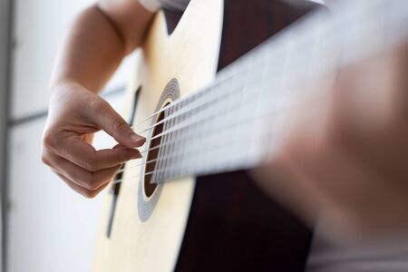 Woman hands playing acoustic classic guitar the musician of jazz and easy listening style select focus shallow depth of field Stock Photo