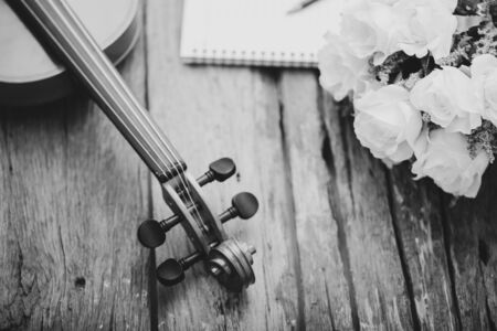 Close-up shot violin orchestra instrumental with vintage tone processed over wooden background select focus shallow depth of field Stock Photo