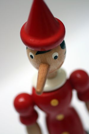 wooden statue of pinnochio representing a gentle liar