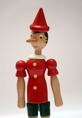 long nose: wooden statue of pinocchio representing a liar