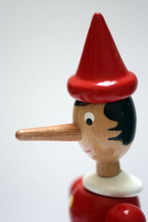 long nose: statue of pinocchio representing a liar Stock Photo