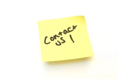 contact us written on a yellow sticky post it note Stock Photo - 5401982