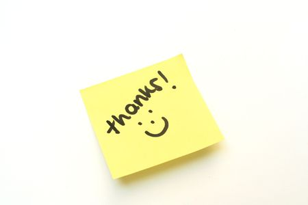 post it note: Thank you with a smile on a yellow post it note